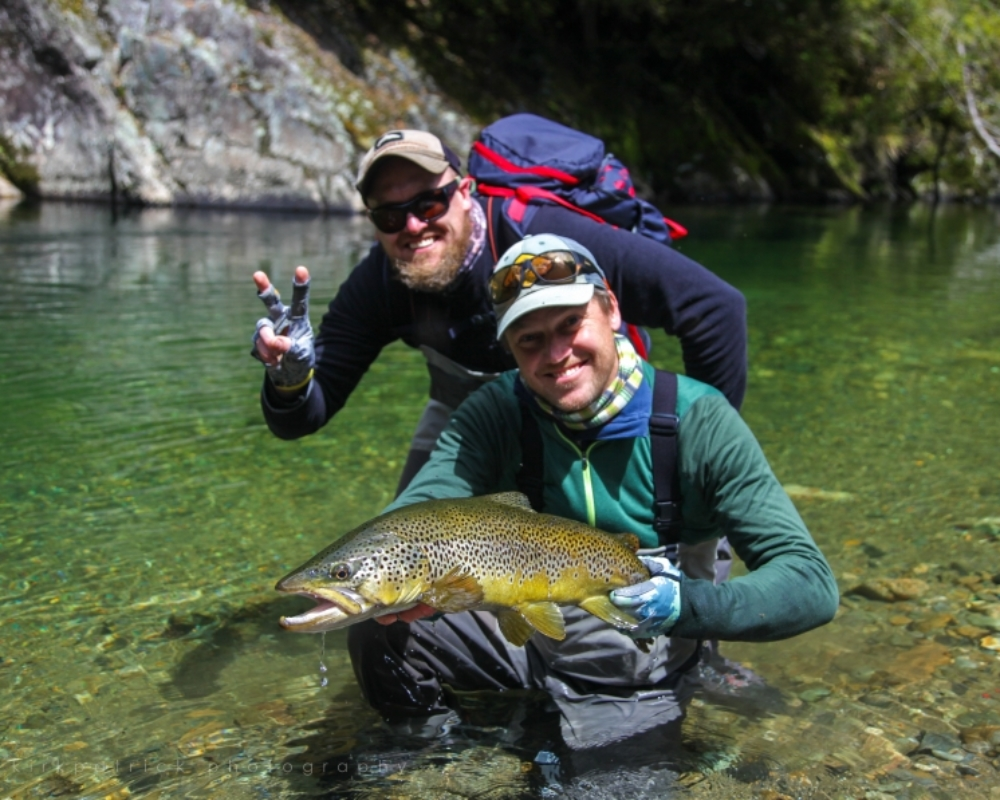 Happy brothers Fly fishing together for Trout in New Zealand rivers